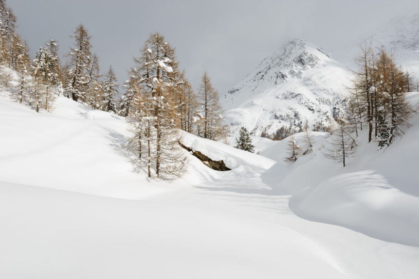 A Swiss winter landscape with a fresh coat of snow, featuring Lac Bleuand the Grande Dent de Veisivi mountainin Arolla, Switzerland. Frosty - Copyright Johan Peijnenburg - NiO Photography