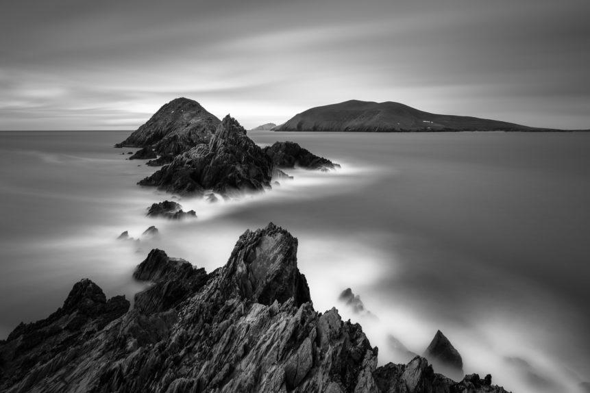 A black & white coastal landscape with rugged cliffs, the Blasket Islands and the Irish North Atlantic coast near Dingle in Kerry, Ireland. The Wild Atlantic - Copyright Johan Peijnenburg - NiO Photography