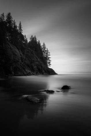Sunrise at China Beach on Vancouver Island with trees reflected in the water of the North Pacific Ocean and wet sand of the beach. Rise & Shine - Copyright Johan Peijnenburg - NiO Photography