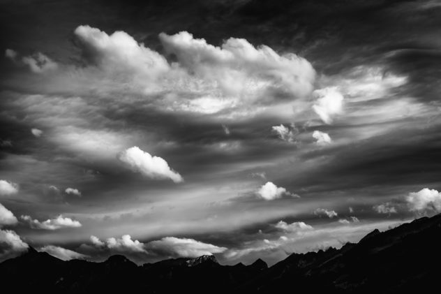 A cloudy sky above the Alps surrounding the Bas-Intyamon valley in  Switzerland, in black and white. Clouds in black & White - Copyright Johan Peijnenburg - NiO Photography