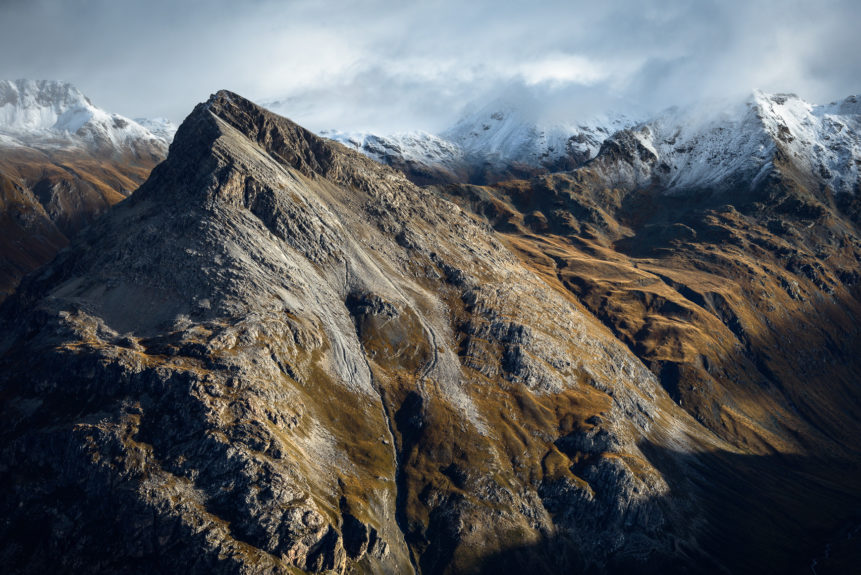 A landscape, featuring the Swiss Alps of Engadin with first autumn snow and snow-dusted mountains peaks bathing in the morning light. In Thin Air - Copyright Johan Peijnenburg - NiO Photography