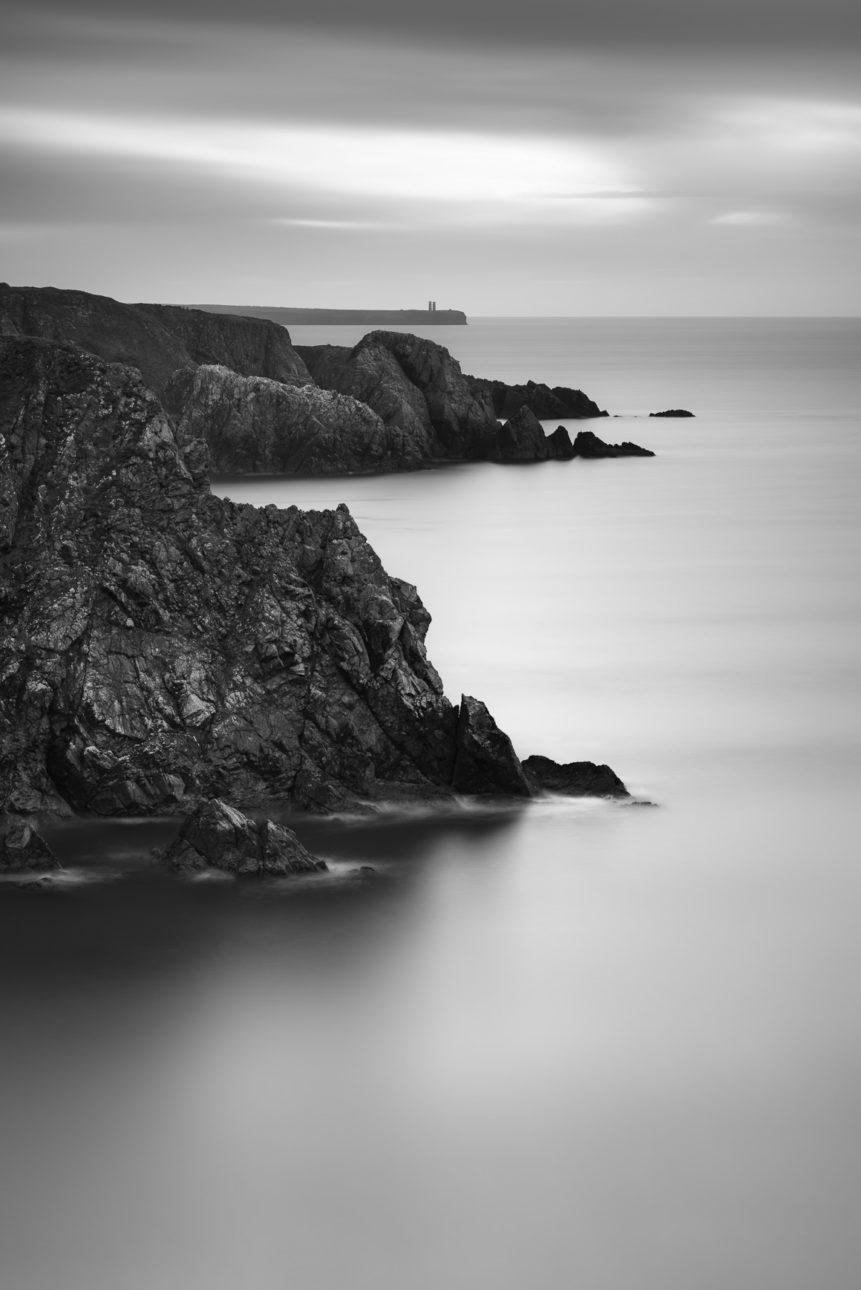An Irish coastal landscape in black & white showing the cliffs near Garrarus beach in County Waterford, Ireland. Rough - Copyright Johan Peijnenburg - NiO Photography