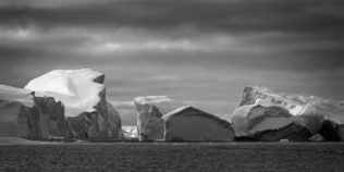 The icebergs of Disko Bay in the Ilulissat Icefjord in Greenland's Disko Bay, close to sunset. Ice Passage - Copyright Johan Peijnenburg - NiO Photography