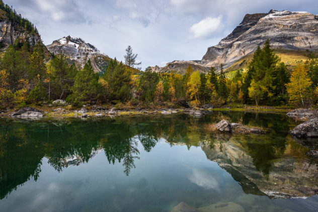 Fall colours and reflections at Lac Bleu in Derborence, with the mountains Les Diablerets and Tête à Pierre Grept in the background. Lac Bleu in Autumn - Copyright Johan Peijnenburg - NiO Photography