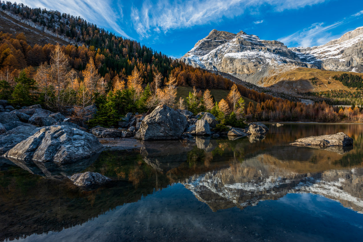 Les Diablerets mountain and trees with fall colours reflected in Lac de Derborence in Switzerland. Lac de Derborence - Copyright Johan Peijnenburg - NiO Photography