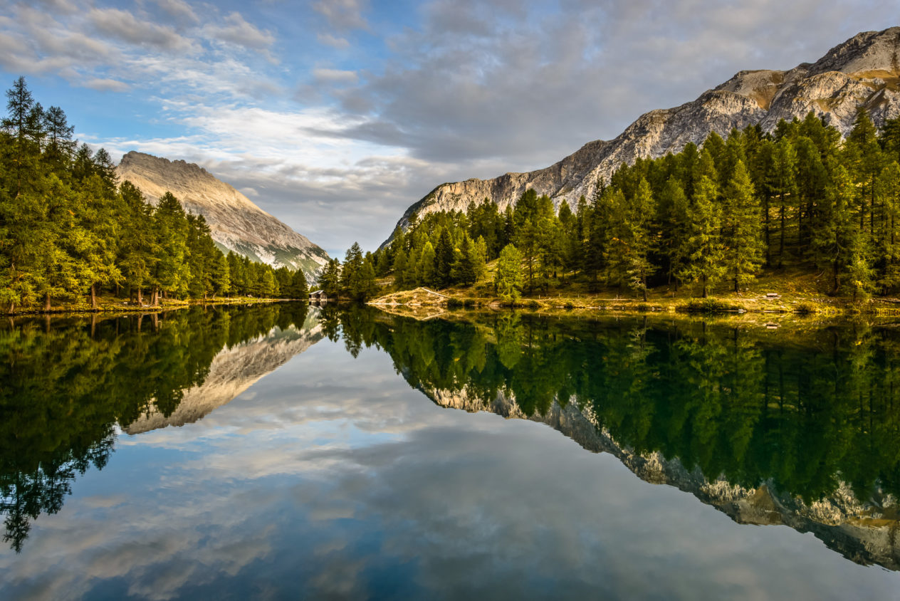 A tranquil sunrise at Lai da Palpuogna with Piz Ela mountain catching first light in the background. This Swiss alpine lake is located at the Albula Pass near Bergün in the canton of Graubünden. Alpine Serenity - Copyright Johan Peijnenburg - NiO Photography