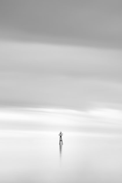 Two birds overlooking a calm Norwegian Sea near Lofoten from a small lighthouse, in a dreamy and soothing minimalist coastal landscape in black & white. Soothing - Copyright Johan Peijnenburg - NiO Photography