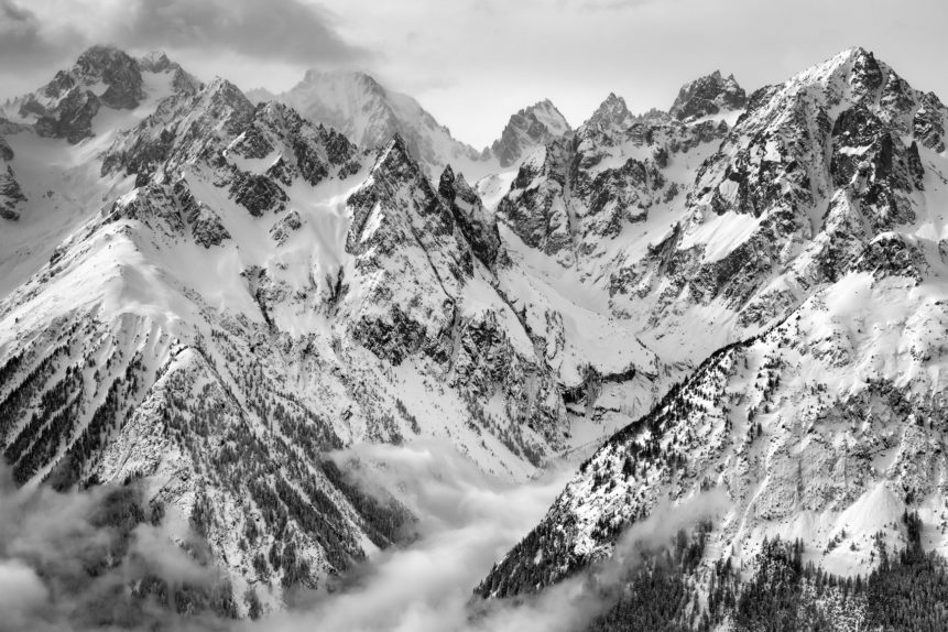 Birds-eye view of the alps of the Mont Blanc massif in winter, in a mountain landscape in B&W. Come fly with me - Copyright Johan Peijnenburg - NiO Photography