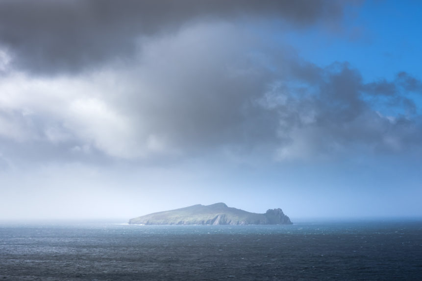 An Irish coastal landscape, showing the Blasket Islands getting closed in by heavy rain in the North Atlantic ocean near Dingle. Mystical - Copyright Johan Peijnenburg - NiO Photography
