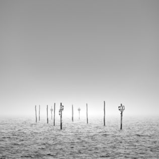 Fine art in B&W, showing a Dutch coastal landscape with signposts warning for cliffs in the Oosterschelde near Tholen in Zeeland. Danger - Copyright Johan Peijnenburg - NiO Photography
