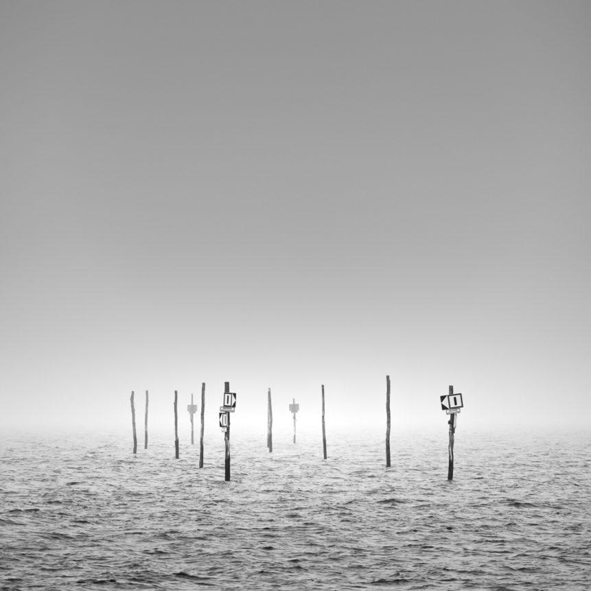 Fine art in B&W, showing a Dutch coastal landscape withsignposts warning for cliffs in the Oosterschelde near Tholen in Zeeland. Danger - Copyright Johan Peijnenburg - NiO Photography