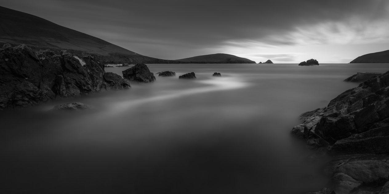 An Irish coast landscape in B&W, showing the rugged Irish coastline and the Blasket Islands near Dingle, in Kerry, Ireland. The Getaway - Copyright Johan Peijnenburg - NiO Photography