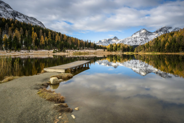 A lake landscape, showing an soothing autumn sunrise at Lej da Staz (Stazersee) in St. Moritz with fall colours and fresh snow on the Swiss Alps. Morning Glory - Copyright Johan Peijnenburg - NiO Photography