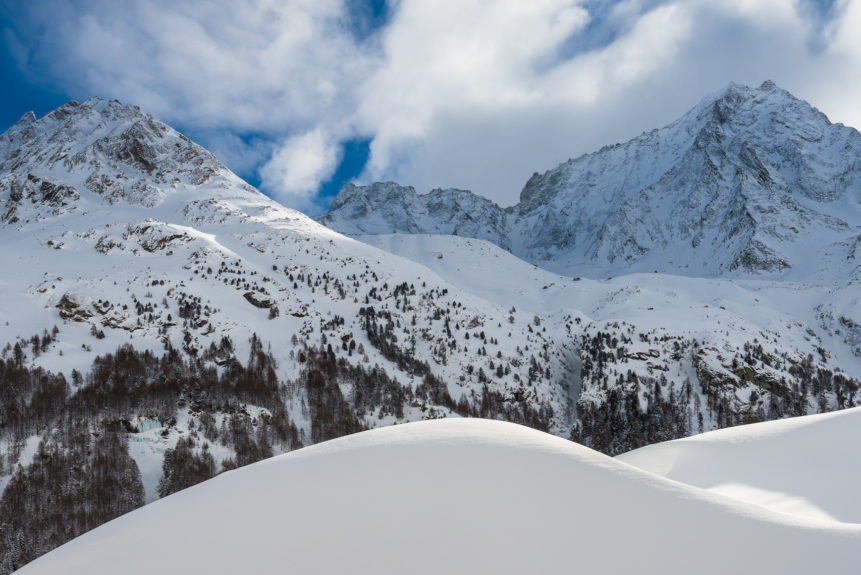 A winter mountain landscape, showing the beauty of the Swiss Alps Dent de Perroc and Grande Dent de Veisivi near Evolène in Valais with snow. Winter Wonderland - Copyright Johan Peijnenburg - NiO Photography