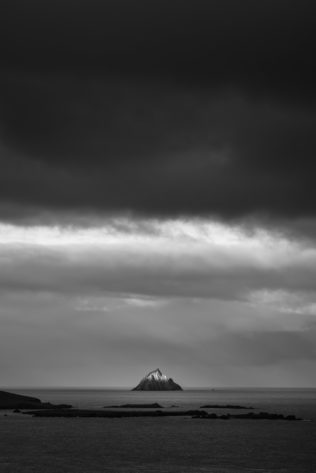 An Irish coastal landscape in B&W with first light on Tearaght Island, one of the Blaskets near the Dingle Peninsula in Ireland. A Touch of Light - Copyright Johan Peijnenburg - NiO Photography