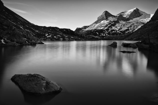 A landscape in black & white showing Lac de Sanetsch at sunrise with the Sanetschhorn mountain in the background. Lac Sanetch in black & white - Copyright Johan Peijnenburg - NiO Photography
