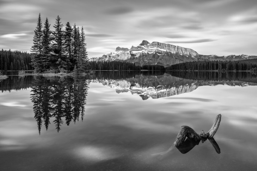A lake landscape in B&W, featuring Two Jack Lake in Banff National Park, Canada, with Mount Rundle and trees reflected in the lake. Reflected - Copyright Johan Peijnenburg - NiO Photography